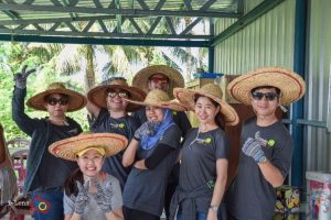 Volunteers pose for photo with sombrero hats